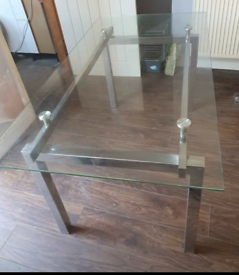 Glass table & 4 chairs.