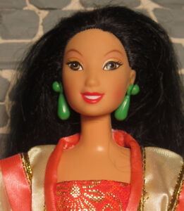 gently used Disney Mulan doll in traditional clothing