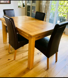 Oak furniture land extendable 6/8 seater dining table + 4 leather chai