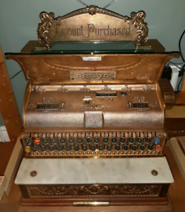 Antique cash register Top Banner
