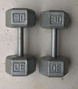 A pair of 30 lbs cast iron hex dumbbells (60 Lbs Total)