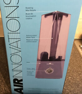Clean mist ultra sonic humidifier....near to new in box.