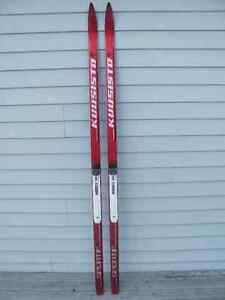 Cross country skiis.poles boots, $64. per set and up