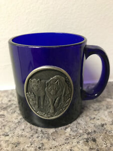 Blue glass coffee mug with pewter wolf badge