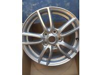 4 Mazda alloys (5 studs) brand new 16 inch