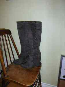 grey suede, knee high boots with ruffle detail.
