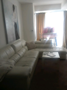White leather sectional couch and ikea table set