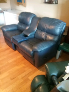 Leather coach recliner.