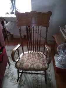 Upholstered cushioned oak rocking chair