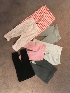 6-12 month pants including Gap, Joe Fresh and Carters. 7 pairs