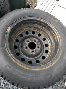 "4 205/65/15 snow tires and 5 x 4 1/2"" steelies"
