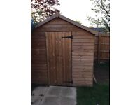 10x7 wooden shed - under a year old