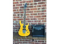 Electric guitar and practice amp with cable,