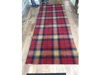 Red tartan carpet remnant.