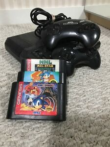 SEGA Genesis console and 3 games