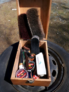 Old shoeshine box with supplies