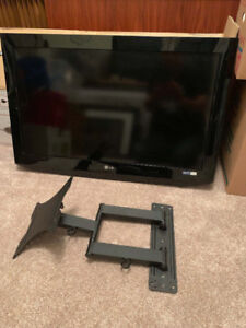 32 inch LG TV, swivel wall mount and Logitech universal remote