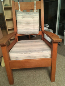 Solid oak captain's chair.