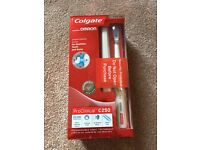 Brand New Colgate Omron Rechargeable Toothbrush
