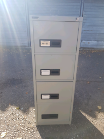 Four drawer metal filing cabinet with key, delivery available