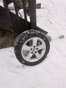 Like new 205 60 16 snow tires on 5X114 alloy rims