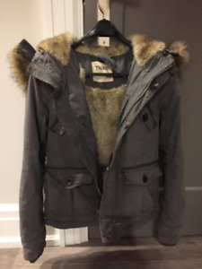 A newer TNA ladies jacket in size small