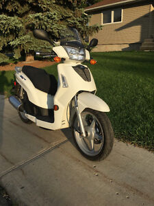 (REDUCED  $2500 OBO )   WE PUT 95km on it !!!   New was $4000