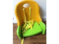 Baby Booster Chair - portable and folds up.