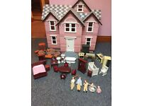 Immaculate doll house with around £100 of accessories