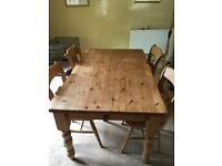 Reclaimed pine farmhouse table and 4 chairs