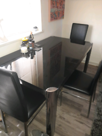 Black and chrome smoked glass dining table with 3 chairs