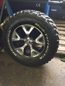 265/70/17 New BF Goodrich KM2 M/T with Jeep Rims set of 4