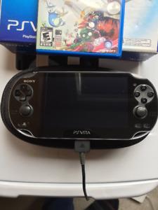 Playstation Vita- OLED Model + 8gb memory card+ 3 games