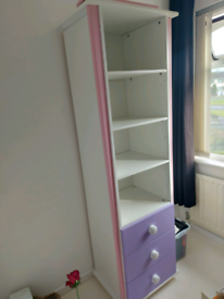 Purple and pink bookshelf and chest of drawers