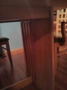 light wood table and six chairs...TABLE NEEDS REFINISHING