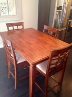 Solid wood table and 4 matching chairs