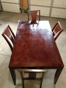 "Formal dining table with 4 chairs. 66""x 38""x 30"" tall."