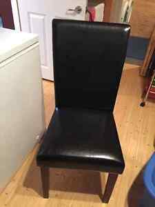 Two black and brown dining chairs