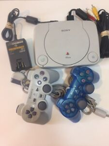 PlayStation Ps1 Slim Console and 2 controllers