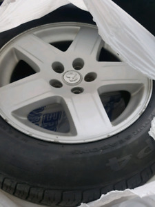 "17"" dodge rims with 215/65/17 pirelli 4s tires"