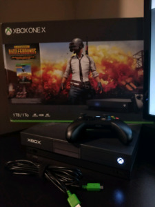 Xbox one x with 100 games