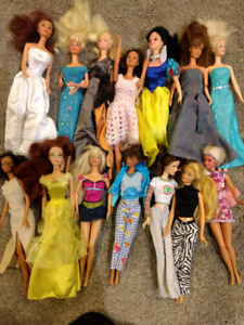 14 barbies plus kitchen, bed, many many outfits etc