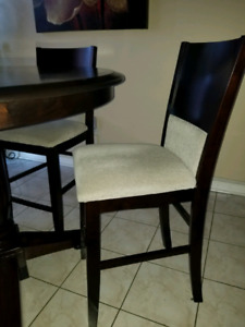 wooden table set with chairs