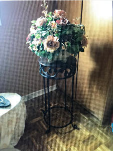 Brown Side Table With Flower Arrangement