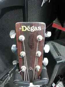 El Degas acoustic guitar. We sell used goods. 105975