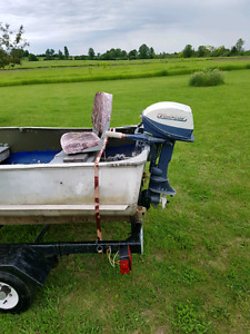 Boat, motor and trailer for sale $1200.00 OBO
