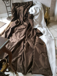Brown silk lined pinch pleated drapery panels