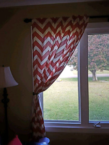 Chevron curtain panels light red in color
