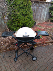 Weber BBQ and its portable Cart