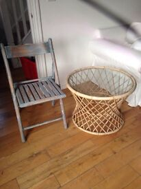 Fold up chair with a painted distressed look and wicker table